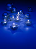 Art Christmas candles on a blue background Stock Photography