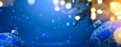 Art christmas decoration on blue snow background Stock Images