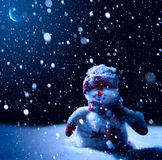 Art Christmas night - background with snowman in the snow stock photography