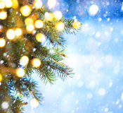 Art Christmas tree branch and snow fall Royalty Free Stock Photo