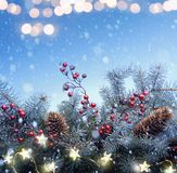 Art Christmas tree and holidays light decoration on blue snow ba stock photo