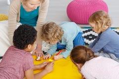 Art class in kindergarten. Group of kids in art class in kindergarten stock images