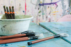 Art Class. Paintbrushes and other supplies on a desk in art class royalty free stock photos