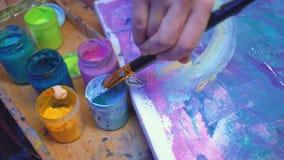 Art class hand acrylic paint brush abstract work