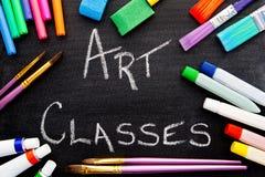 Art Classes. Handwritten on chalkboard with art equipment stock photos