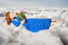 Art collage. beauty young woman on sky Royalty Free Stock Photography