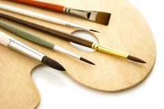 Art color brushes on woode palette isolated Royalty Free Stock Images