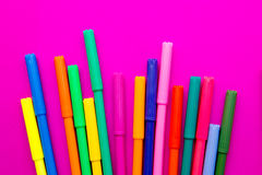 Art - colored pens on pink background Stock Photos