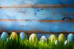 Art Colorful easter eggs. Background with easter eggs on green g royalty free stock image
