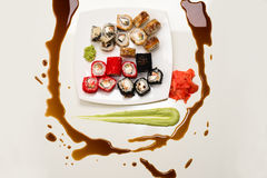 Art composition of assorted rolls, ginger, wasabi and soy sauce Royalty Free Stock Image
