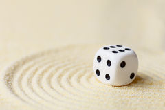 Art composition from playing dice on sand Stock Image