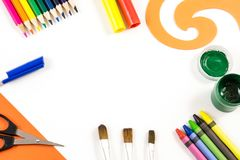 The art concept. The office supplies prepared for drawing on the white background with a space on the center of composition Royalty Free Stock Images