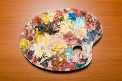 The art concept with palette and brushes Stock Photography