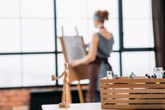 Art contribution conceptual mannequin lady drawing. Art contribution. Conceptual articulated mannequin sharing knowledge and achievements. Lady drawing in royalty free stock images