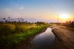 Art countryside Landscap; road in the farmland field after rain Royalty Free Stock Image