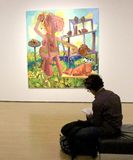 Art course. Student takes notes at American artist Dana Schutz exhibition At MAC Museum in Montreal until January 10th 2016 Royalty Free Stock Photos