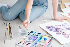Art craft painter work woman mix watercolors draw. Art craft and creativity. painter at work. woman mixing watercolors when drawing a beautiful floral picture Stock Image