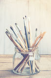 Art and craft tools. On grunge wooden background in high key Royalty Free Stock Image