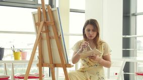 Art, creativity, hobby, job and creative occupation concept. Young cute girl draws in art workshop. Art, creativity, hobby, job and creative occupation concept stock video