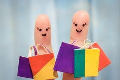 Art de doigt d'amis heureux avec des paniers Images stock