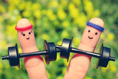 Art de doigt d'un couple heureux dans les sports photo libre de droits