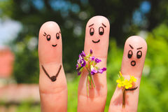Art de doigt Les hommes donnent des fleurs de fleurs à la femme Photo libre de droits