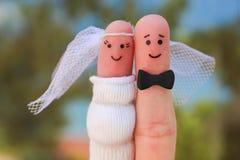 Art de doigts d'un couple heureux Concept du mariage de fusil de chasse Images libres de droits