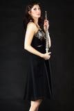 Art De fluitist van de vrouwenfluitist met fluit Muziek Stock Afbeeldingen