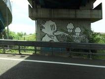Art de graffiti le long d'autoroute Photographie stock libre de droits