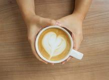 art de latte de prise de main photo libre de droits