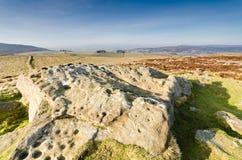 Art de roche de cuvette et de boucle de Lordenshaws Photographie stock libre de droits