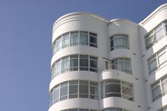 Art Deco Apartment Building #2. A large art deco apartment building displays it's face of curved windows and balcony's royalty free stock photos