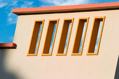 Art Deco balcony. Pastel colors against the bright blue morning sky royalty free stock photography