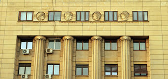 Art Deco: Bucharest, Romania - Bas relief heads and columns Royalty Free Stock Photo