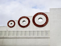 Art Deco Circles In Red. An architectural detail of three red circles on the exterior of a building in the historic Art Deco district of South Beach in Miami stock image
