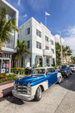 The Art Deco district in Miami and a classic oldsmobile car Stock Images
