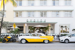 Art deco hotel Avalon in Miami Beach, Florida. Classic car and motorbike in front of art deco hotel Avalon on Ocean Drive in South Beach district of Miami Beach Stock Images
