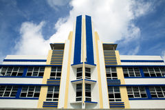 Art Deco Hotel Facade. Close-up image of a South Beach Art Deco Hotel Facade on Ocean Drive with blue sky and clouds overhead royalty free stock images