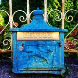 Art deco letterbox. On railings outside a village house in Normandy, France Stock Images