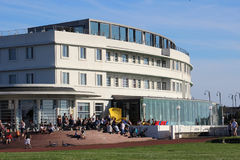 Art deco Midland Hotel, promenade, Morecambe. People on steps outside the famous art deco style Midland Hotel on the seafront at Morecambe in Lancashire royalty free stock photography