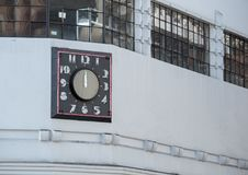 Art deco neon clock in the day outdoors Royalty Free Stock Image