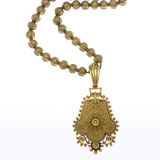 Art Deco Pendant Necklace. With filigreed gold on white Royalty Free Stock Photography
