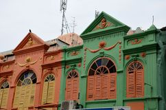 Art deco Peranakan colorful architecture houses Hat Yai Thailand. Hat Yai, Thailand - August 30, 2015: Two peranakan style designed houses on a street in Hat Yai Stock Images