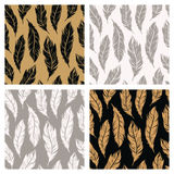 Art Deco seamless patterns set with feathers symbols with golden Stock Photo