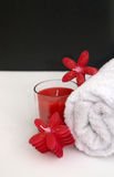 Art Deco Spa. Black and white art deco theme spa and bathroom session with relaxing red candles and bath towel Stock Photo