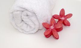 Art Deco Spa. Relaxing red scented candles and crisp white bath towel for a soothing bath time Stock Photography