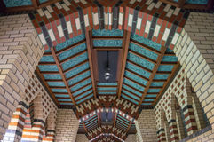 Art Deco style brick design on ceiling of hallway. Ceiling of the hallway in Benedictine Abbey as you enter the sanctuary with brick work in Art Deco style from Stock Photography