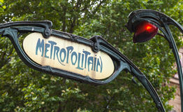 Art-Deco styled Street sign, Paris Metro. Art-Deco styled Street sign with red light at the entrance to the Paris Metro royalty free stock photo