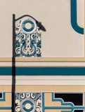 Art Deco theater exterior. Street lamp shadow on Art Deco theater wall royalty free stock photos