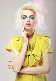 Art Deco. Vivid Blond Hair Woman with  Conspicuous Makeup. Glamor Stock Image